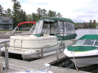 Poonton Boat at                   Paradox Dock Adirondack Lake Placid New York vacation                   waterfront lakefront rental property house home camp