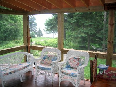 porch from inside Adirondack Lake                     Placid New York vacation waterfront lakefront rental                     property house home camp